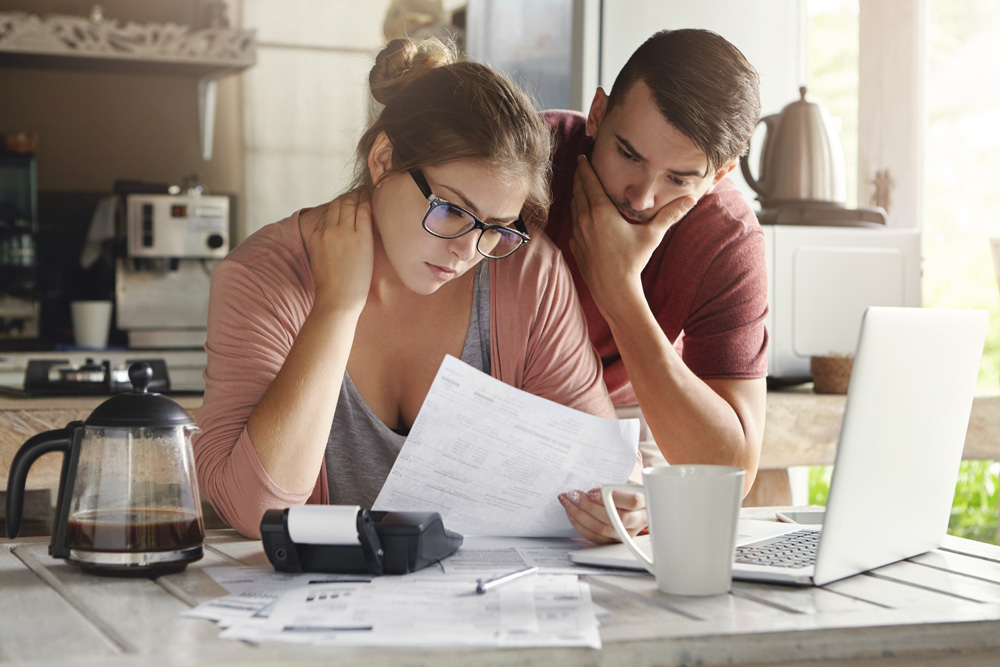 couple reviewing bills in the kitchen